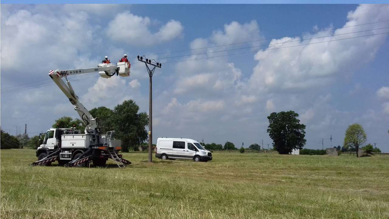 The instalation of insulators on electric power lines in Šurany