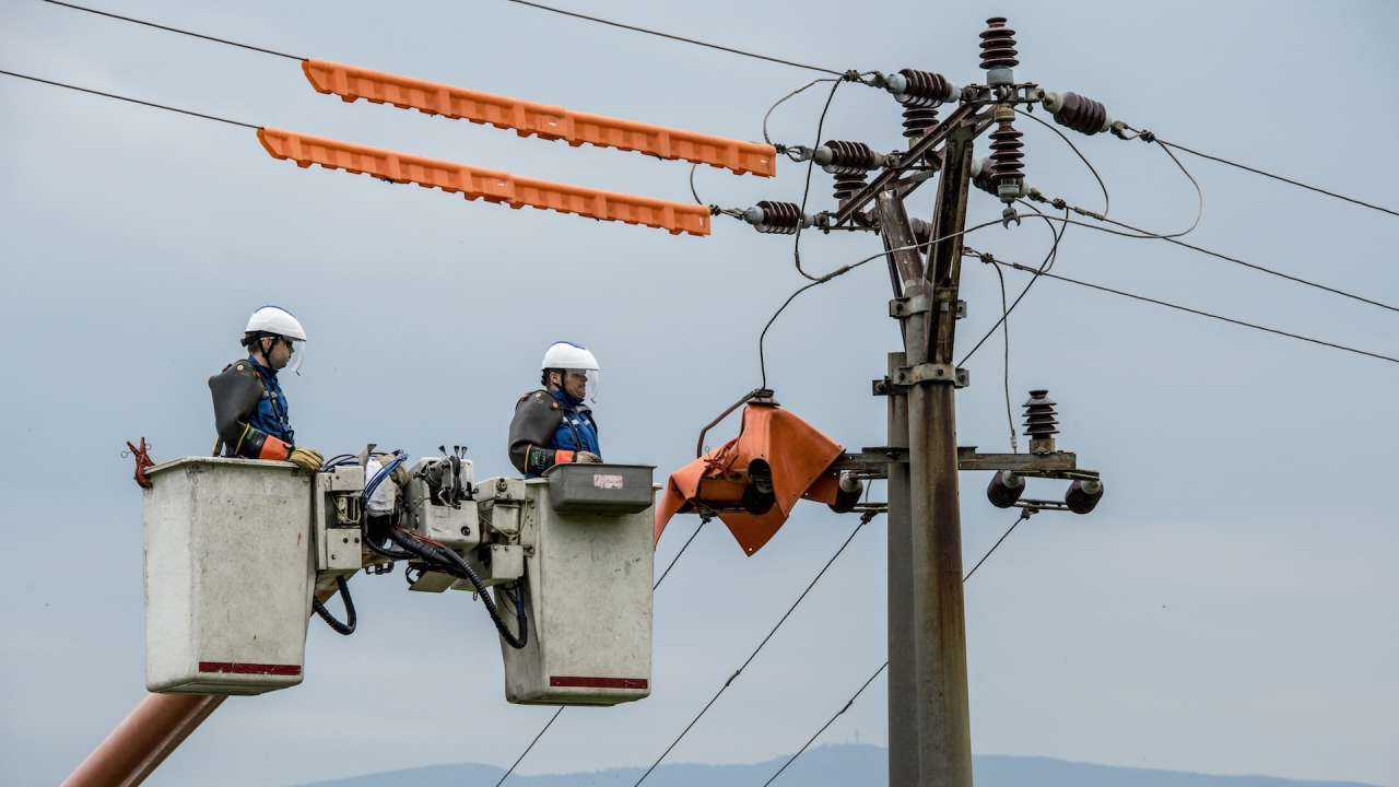 Instalation of insulators on electric power lines in eastern part of Slovakia